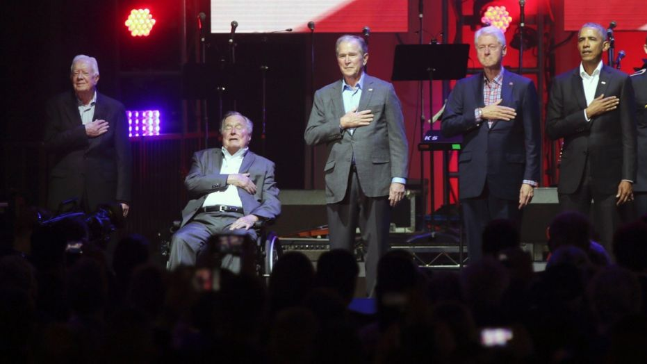 Former Presidents, left to right, Jimmy Carter, George H.W. Bush, George W. Bush and Barack Obama appeared together Saturday for the first time since 2013.