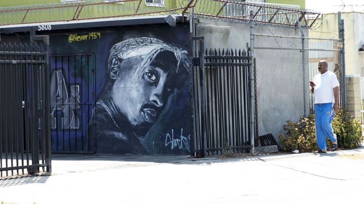 A wall dedicated to the memory of US rapper Tupac Shakur is seen on May 26, 2016 in Los Angeles, California. Twenty years after his death, Tupac still reigns. Other rappers have succeeded him in stardom, and promotional efforts around Tupac have been haphazard, but the artist who died at age 25 on September 13, 1996, in Las Vegas, maintains a hold that is among the most enduring in recent times. / AFP / VALERIE MACON / TO GO WITH AFP STORY by Shaun TANDON, '20 years on, Tupac reigns as potent gl