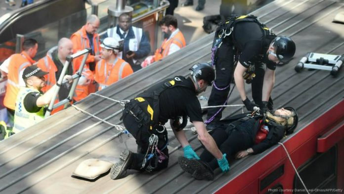 Extinction Rebellion protests: Activists glue themselves to London train on third day