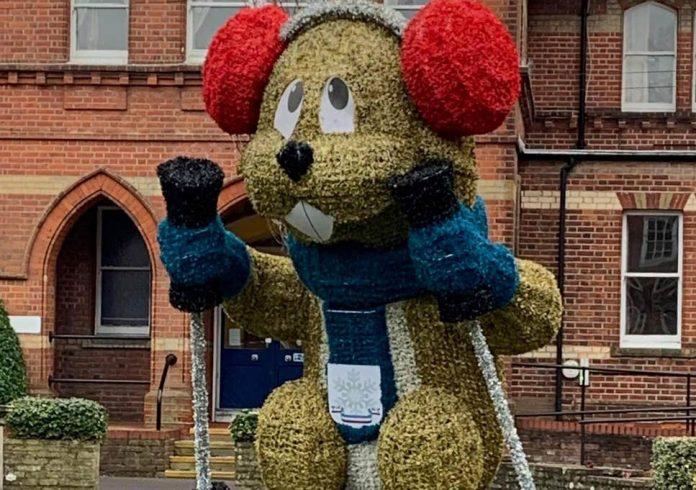 Town's Christmas display splits opinion with giant neon marmot