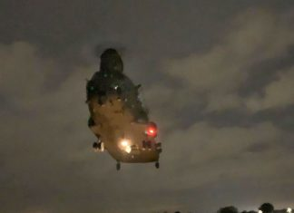 UK flood warnings: helicopter sent to help severely flooded regions