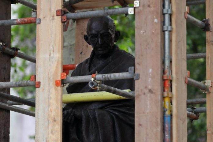 Leicester: Gandhi statue hidden by police after threat by Black Lives Matter movement