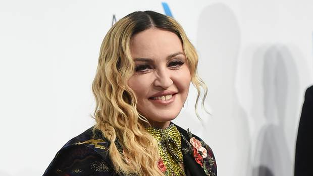 Madonna to direct and co-write her own biopic, Report