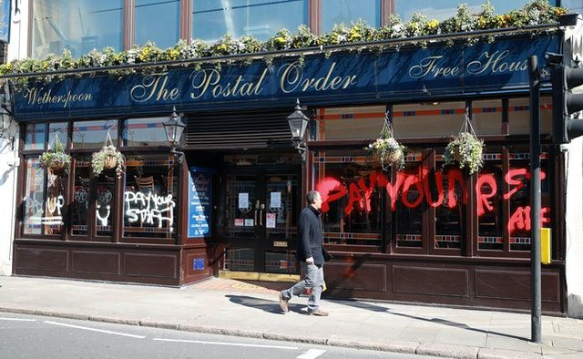 Wetherspoon to cut jobs after swinging to a loss, Report